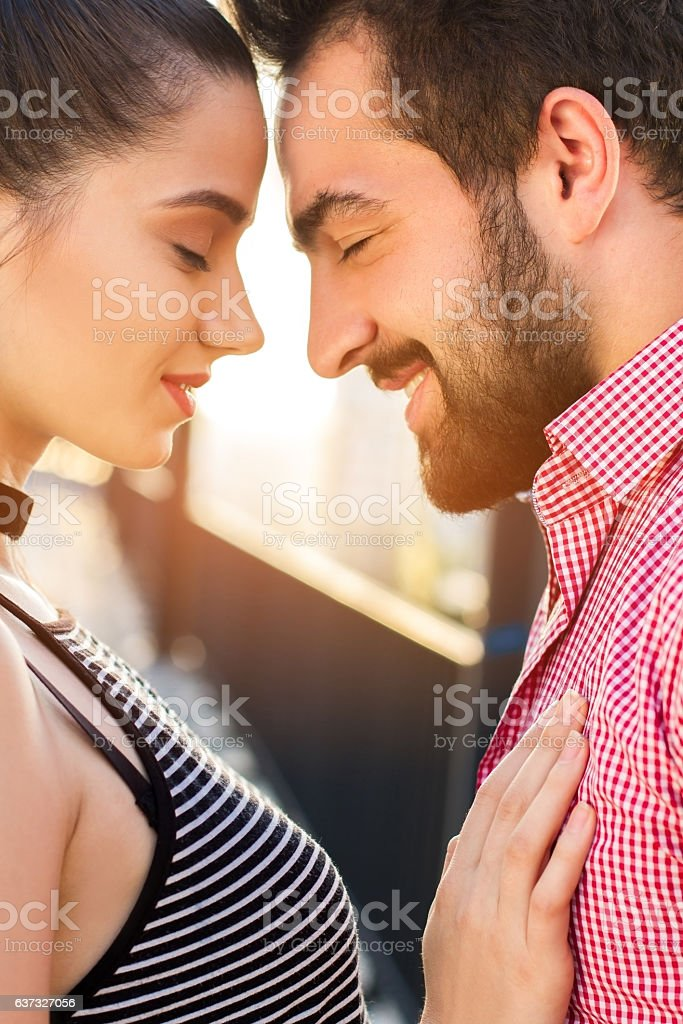 Side view of couple's faces. stock photo
