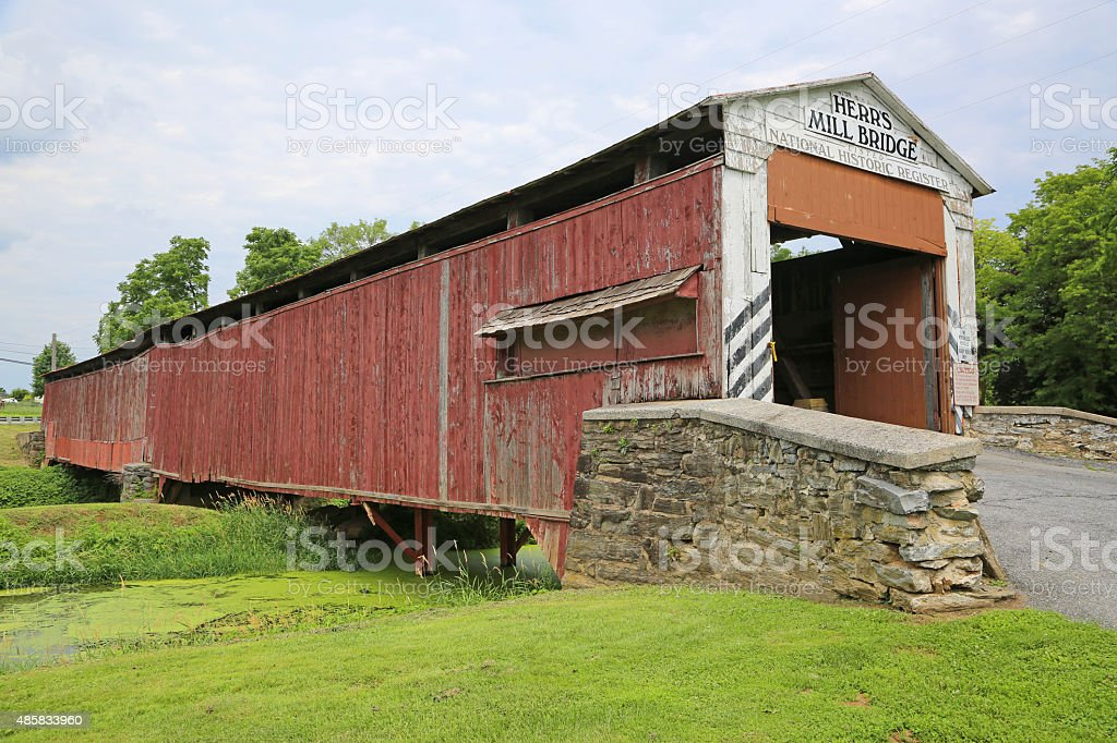 Side view of covered Herr's Mill bridge stock photo