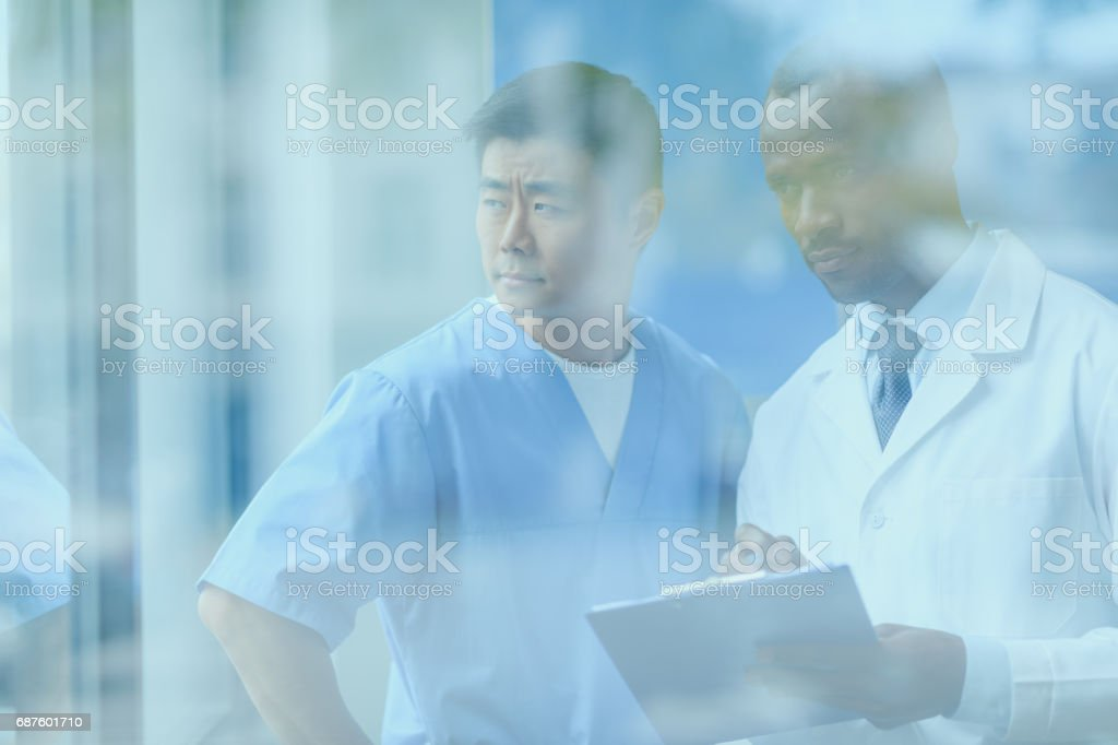 side view of doctors discussing work, doctor conference concept stock photo