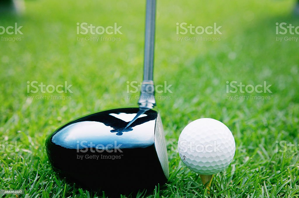 Side view of driver and golf ball on a tee stock photo
