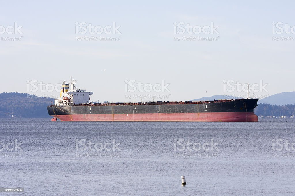 Side View of Empty Cargo Ship at Anchor royalty-free stock photo