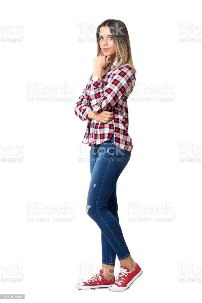 Side view of gorgeous young beauty with hand under chin stock photo