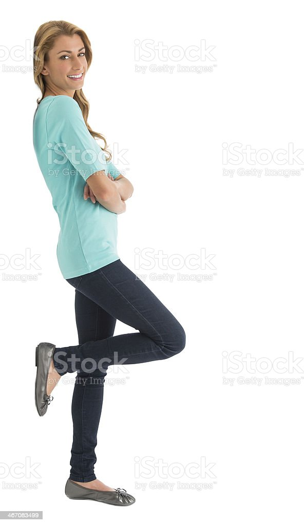 Side View Of Happy Woman With Arms Crossed stock photo