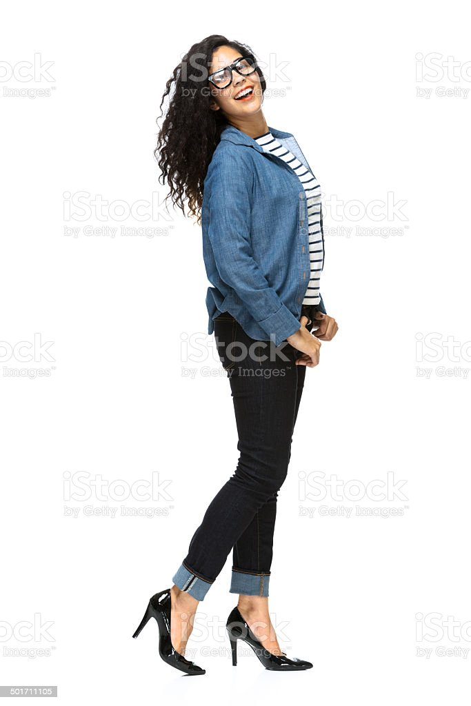 Side view of happy young woman standing royalty-free stock photo