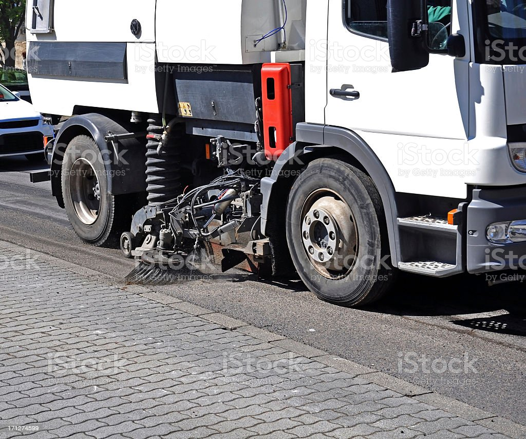 Side view of lower half of a street sweeper stock photo