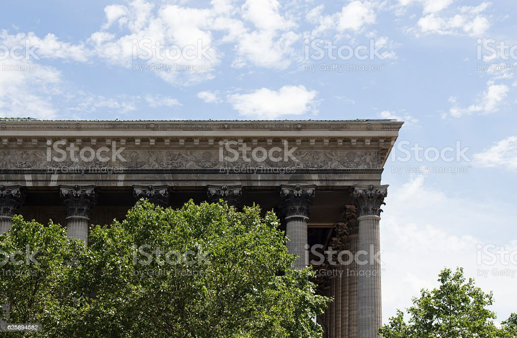 Side view of Madeleine with blue sky background in Paris. stock photo