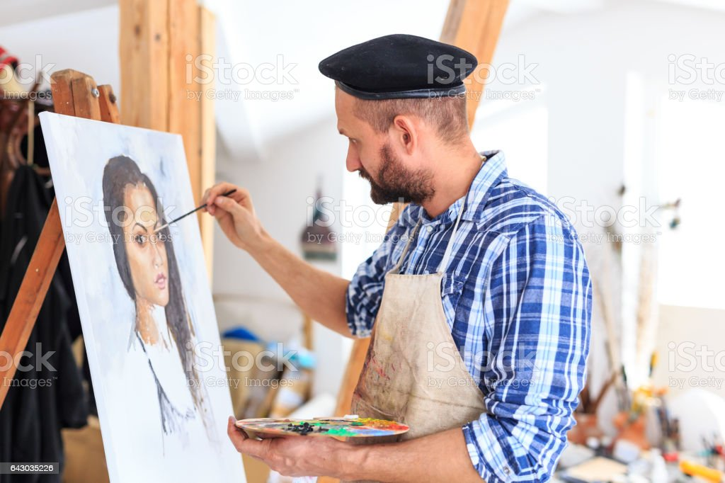 Side view of male painter drawing a portraiture of young woman stock photo