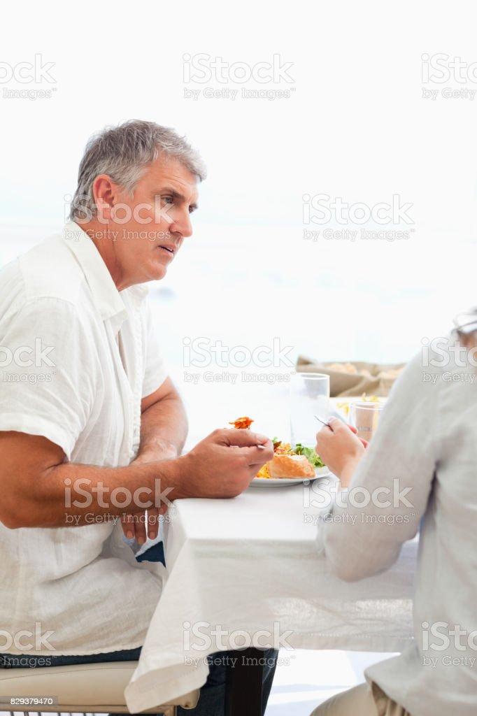Side view of man having dinner stock photo