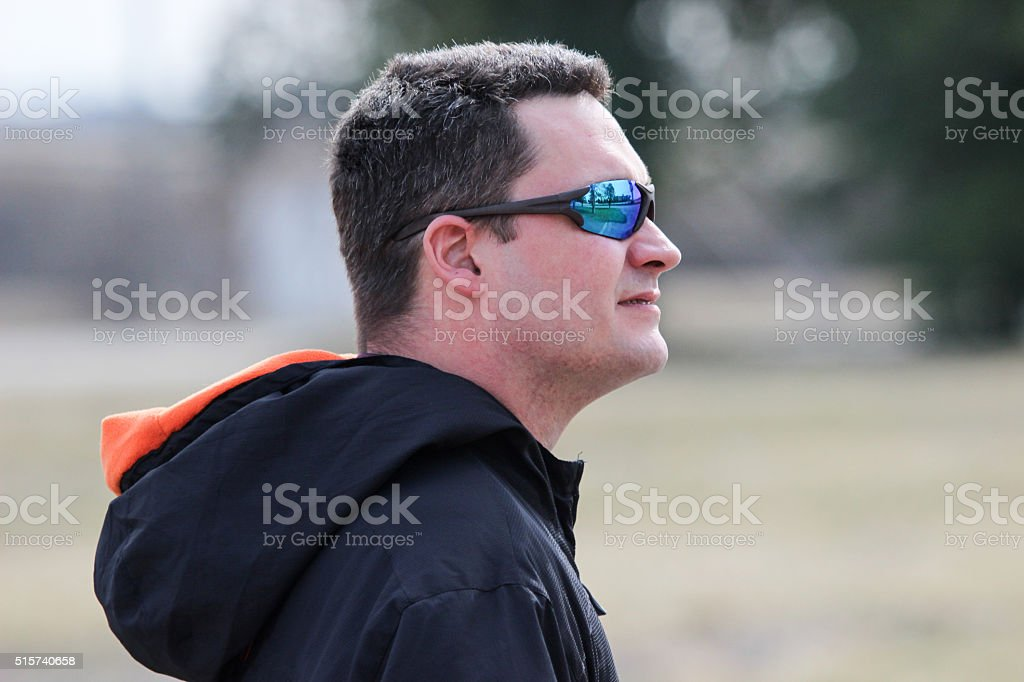 Side View of Man Wearing Sunglasses stock photo