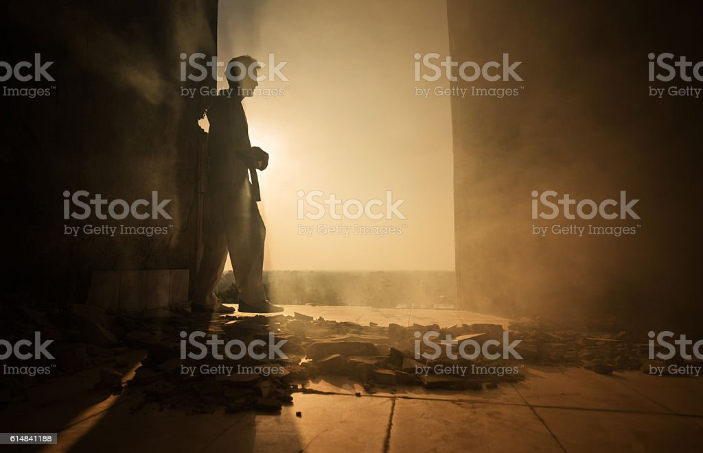 Side view of martial artist among ruins at sunset. stock photo