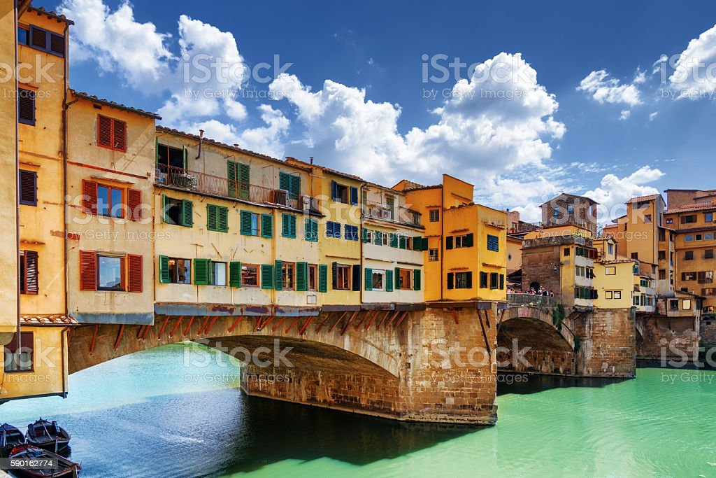 Side view of medieval bridge Ponte Vecchio in Florence, Italy stock photo