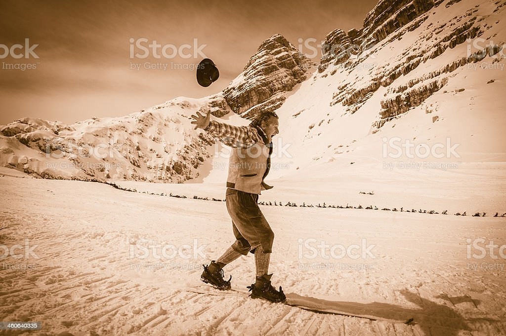 Side view of male adult retro skier at telemark skking, ski equipment...