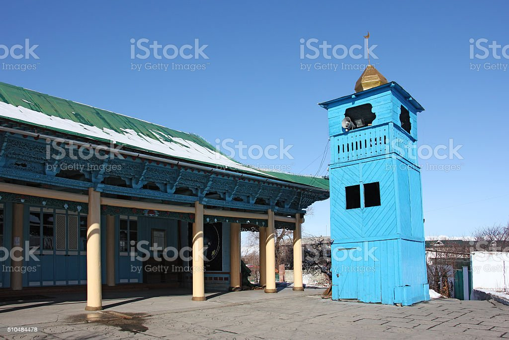 side view of old wooden Dungan Mosque in  Karakol stock photo