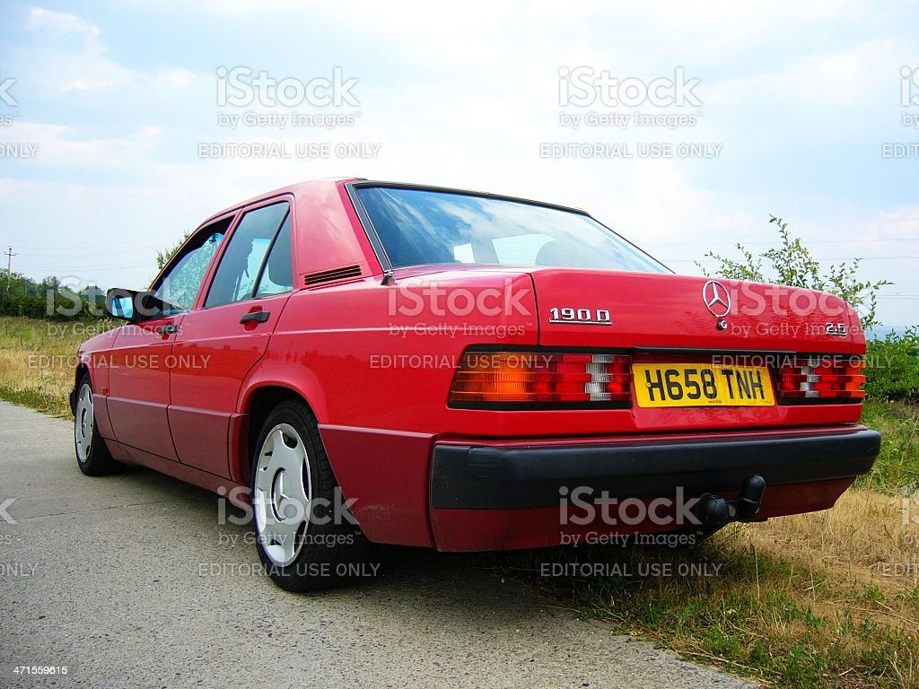 Side view of parked red Mercedes 190D royalty-free stock photo
