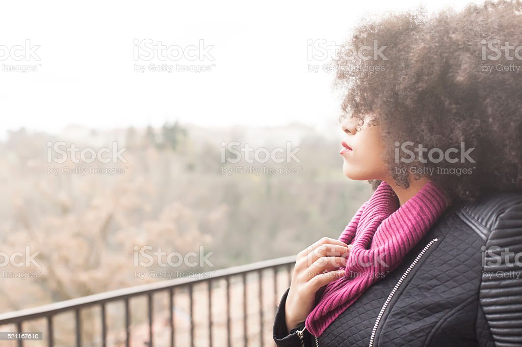 Side view of pensive young woman on bridge stock photo