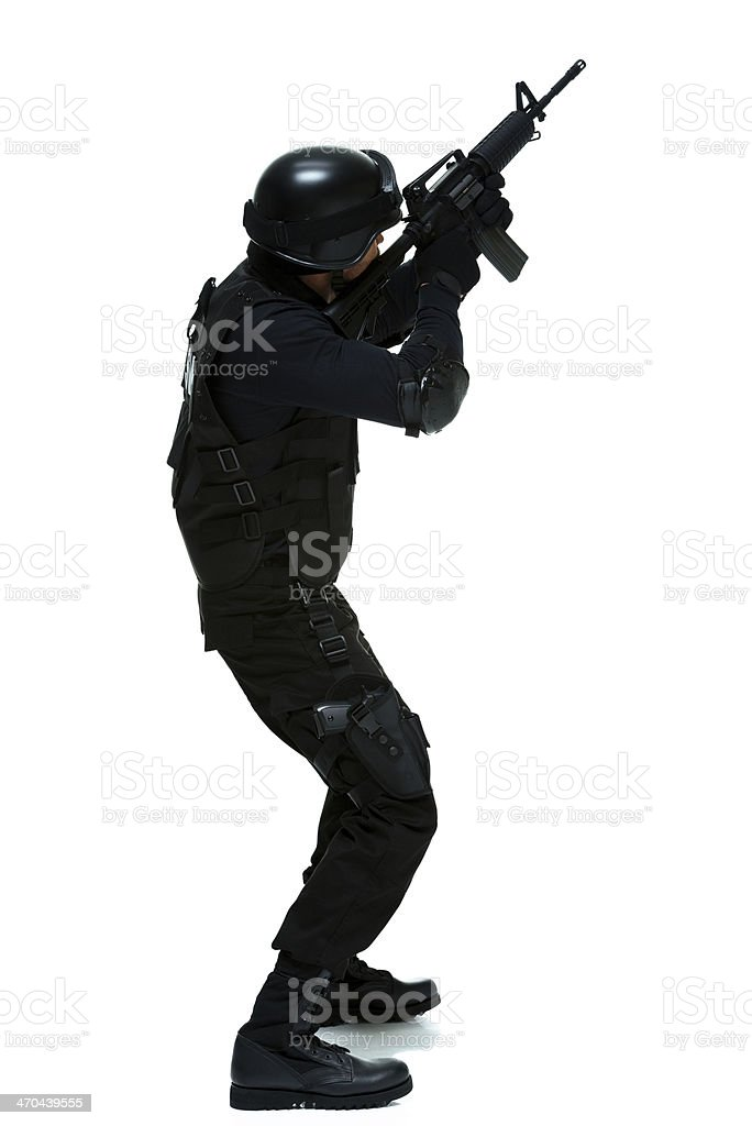 Side view of police in action with rifle royalty-free stock photo