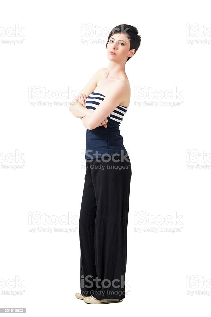 Side view of pretty confident brunette with crossed arms stock photo