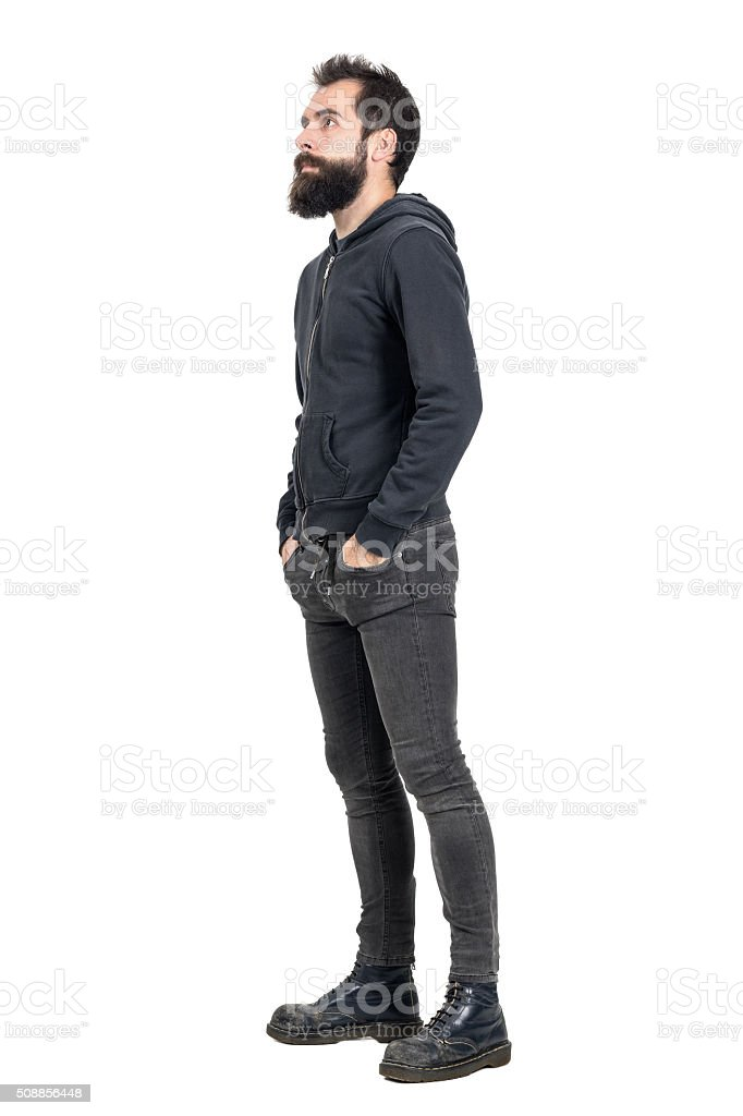 Side view of punker with hands in pockets looking up stock photo