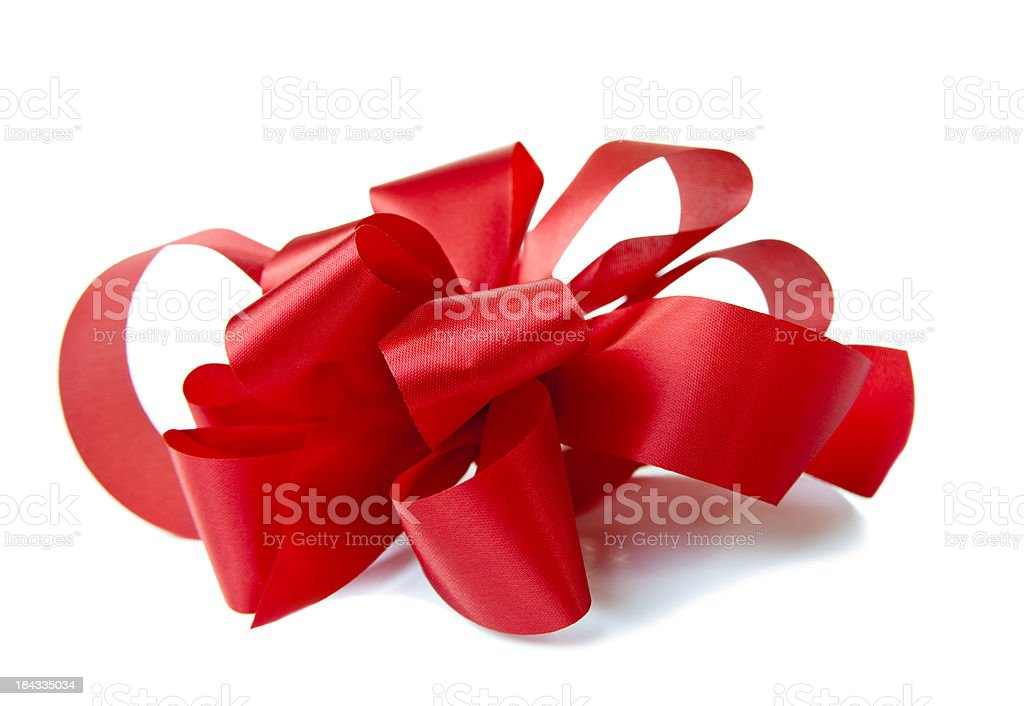 Side view of red handmade bow on white giftbox. Christmas. stock photo