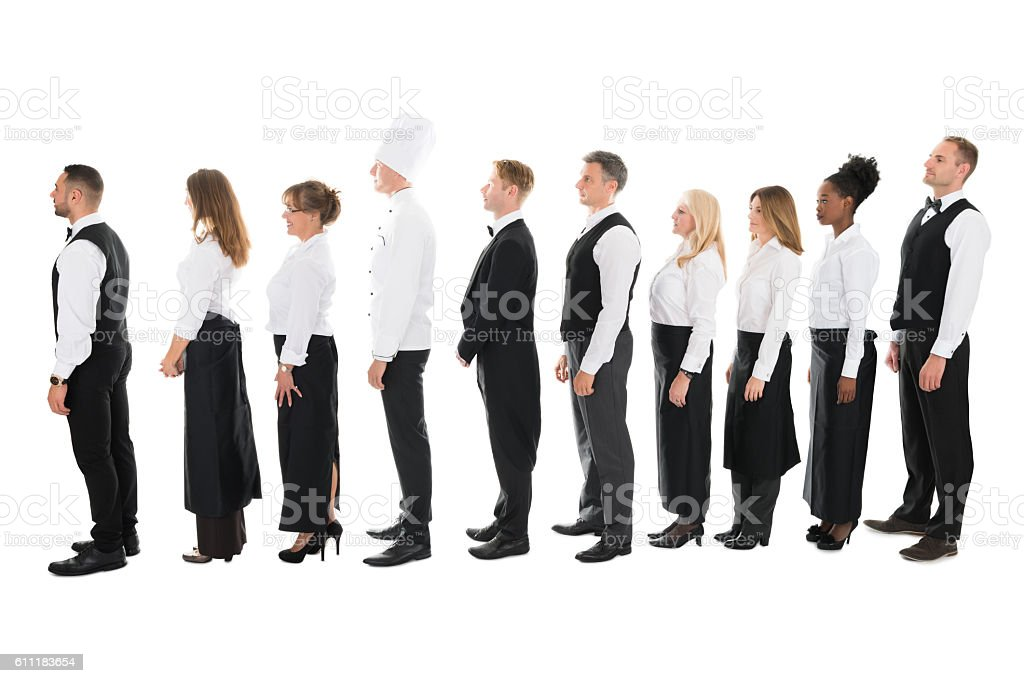 Side View Of Restaurant Staff Standing In Line stock photo