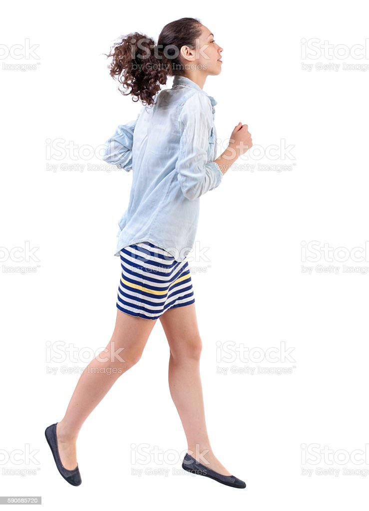 side view of running  woman. stock photo