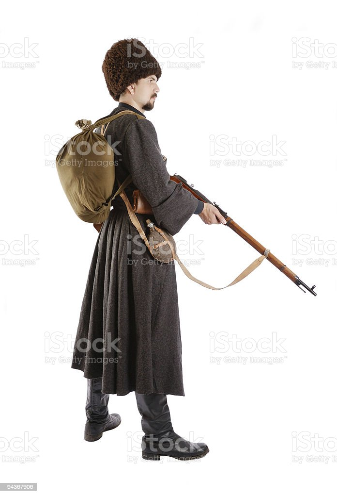 Side view of Russian Cossack with a gun. stock photo