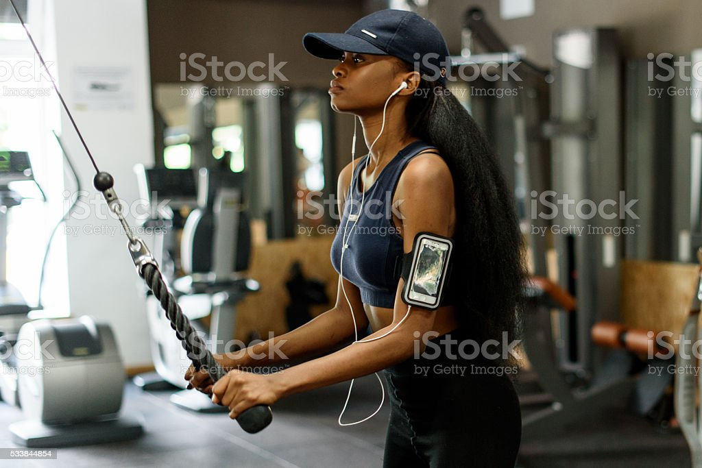 Side view of sexy gorgeous african-american woman working out stock photo