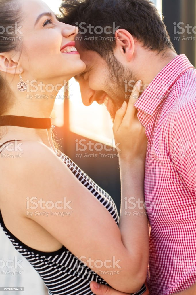Side view of smiling couple. stock photo