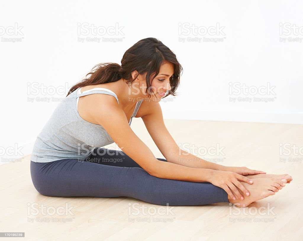 Side view of smiling young girl exercising stock photo