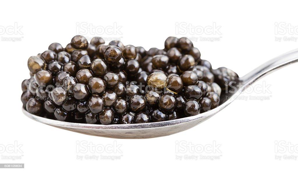 side view of spoon with black sturgeon caviar stock photo