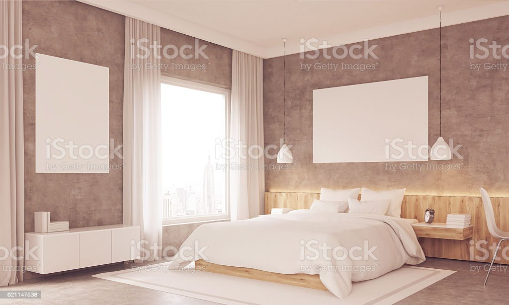 Side view of sunlit bedroom with study corner stock photo