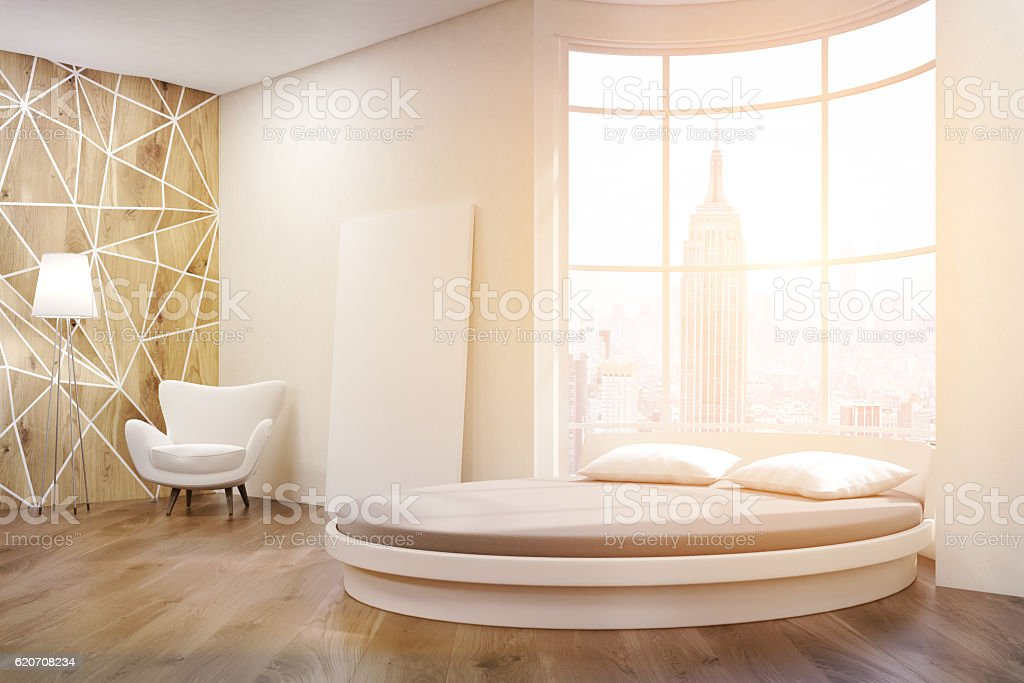 Side view of sunlit round bed bedroom stock photo