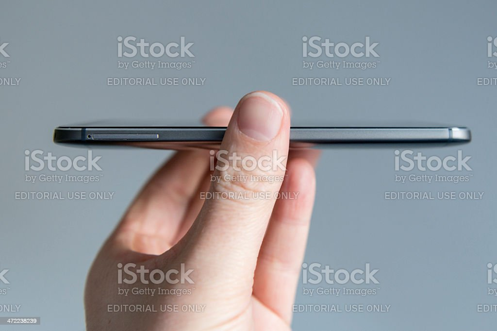 Side view of the HTC One M8 from 2014 stock photo