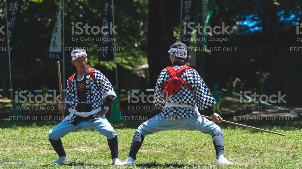Side view of two senior men playing kendo in Japan stock photo