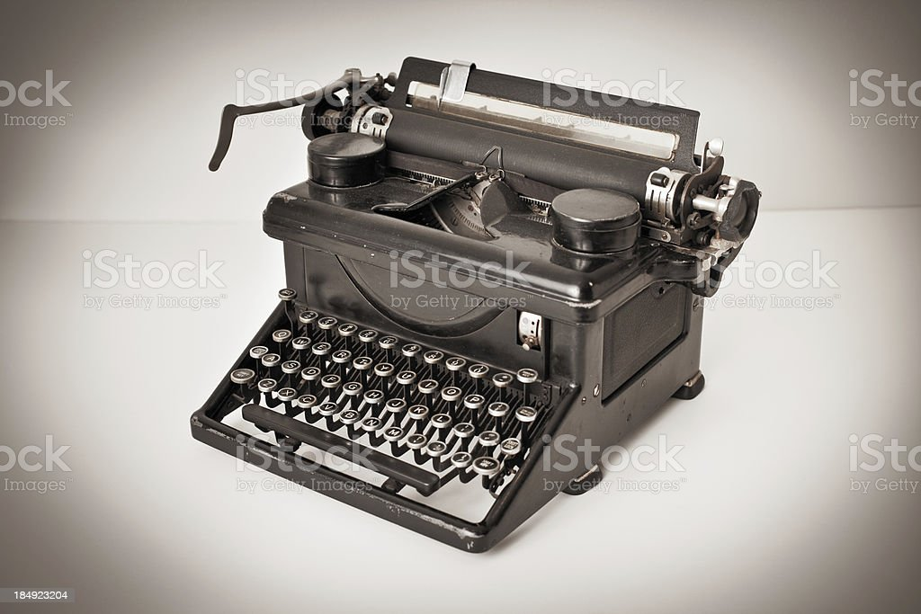 Side View of Vintage Black Typewriter on White Background royalty-free stock photo