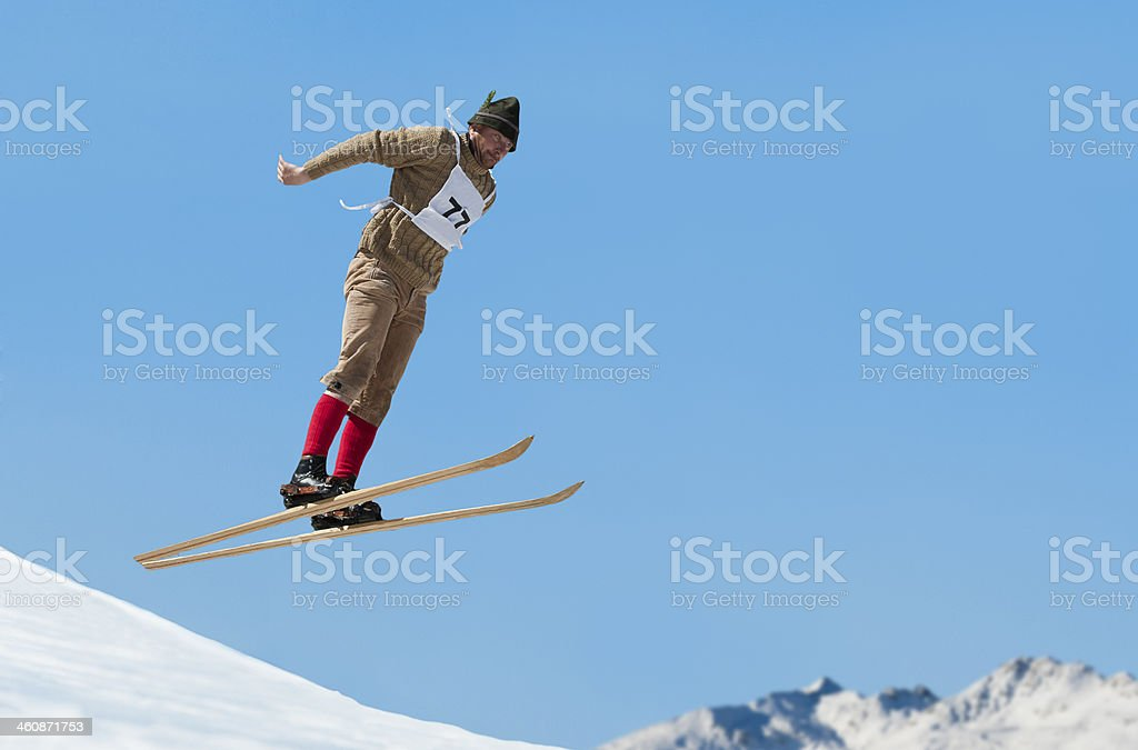Side View of Vintage Ski Jumper in Mid-air stock photo