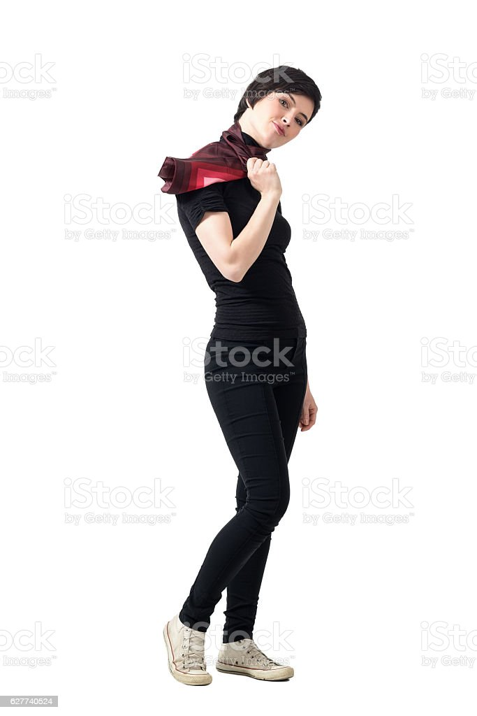 Side view of vogue woman holding scarf looking at camera stock photo