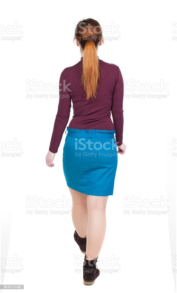 side view of walking  woman in dress stock photo
