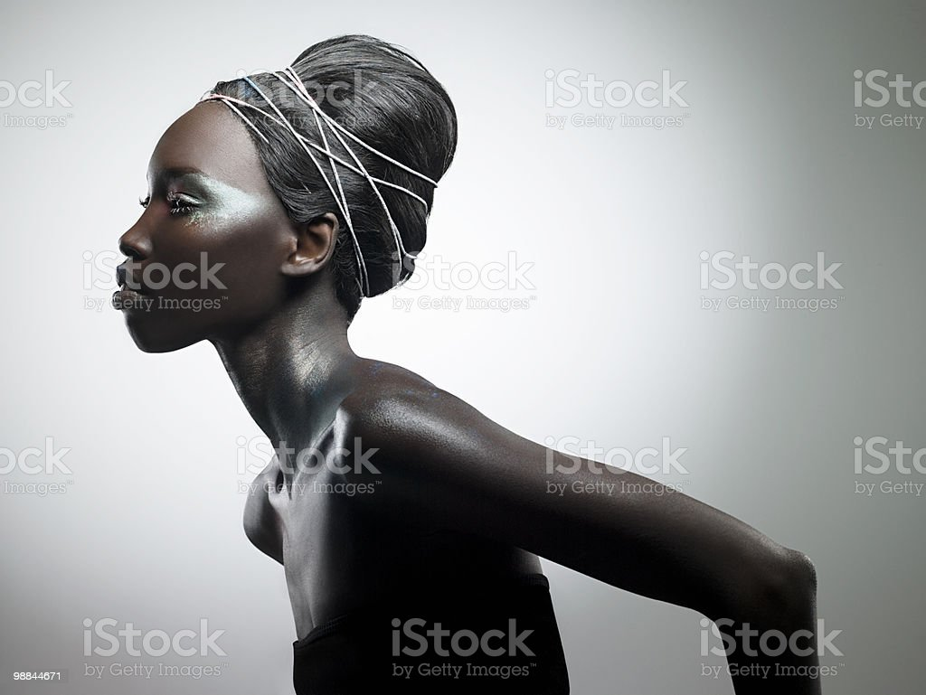 Side view of woman with metallic make up stock photo