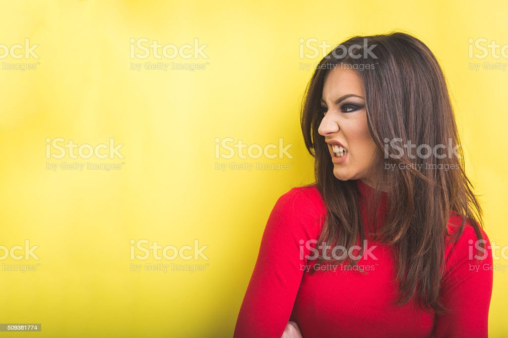 Side view of young angry woman stock photo