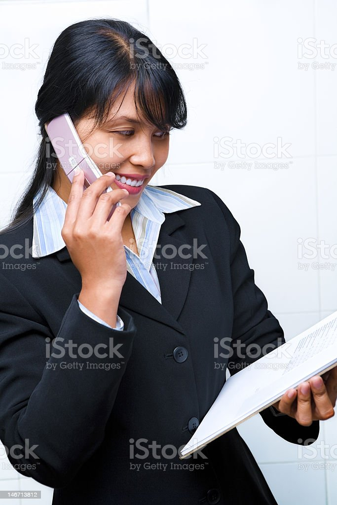 Side view of young businesswoman having dicsussion on phne royalty-free stock photo