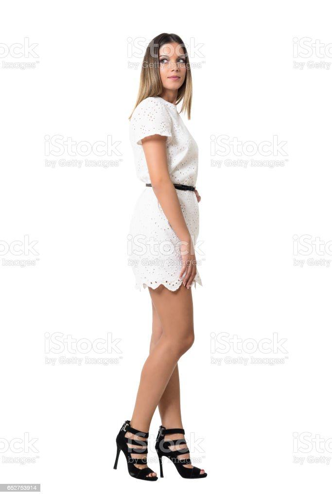 Side View Of Young Fashion Model In Lace White Dress Looking Away ...