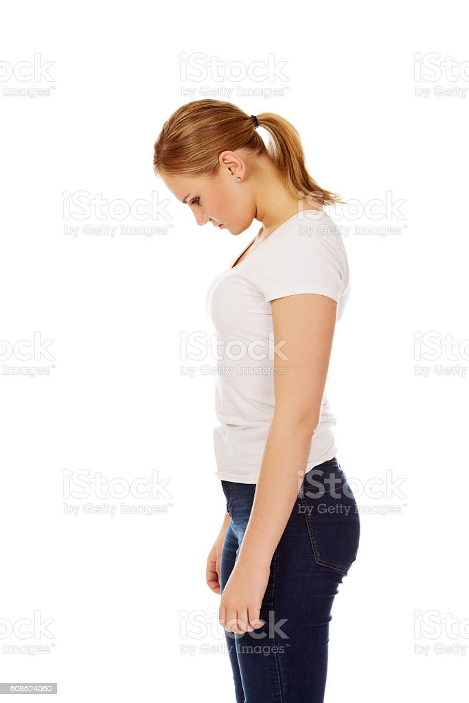 Side view of young sad woman stock photo