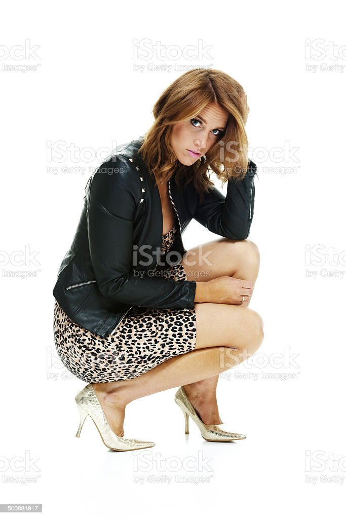 Side view of young woman crouching royalty-free stock photo