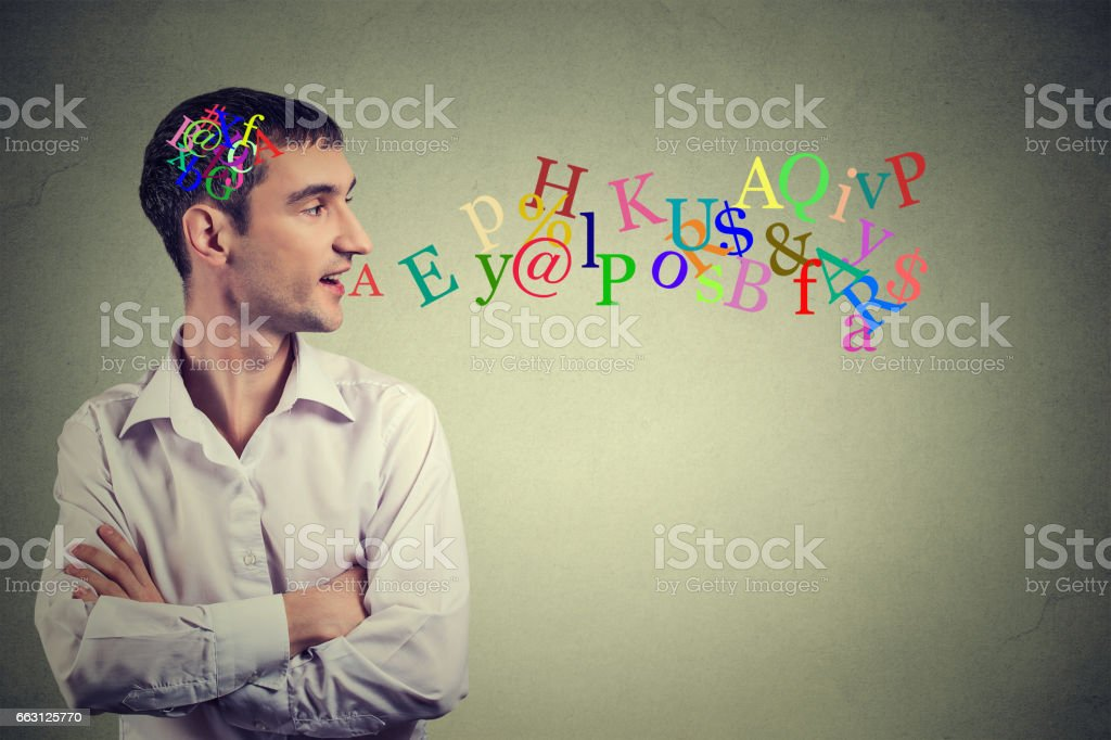 Side view portrait man talking with alphabet letters stock photo