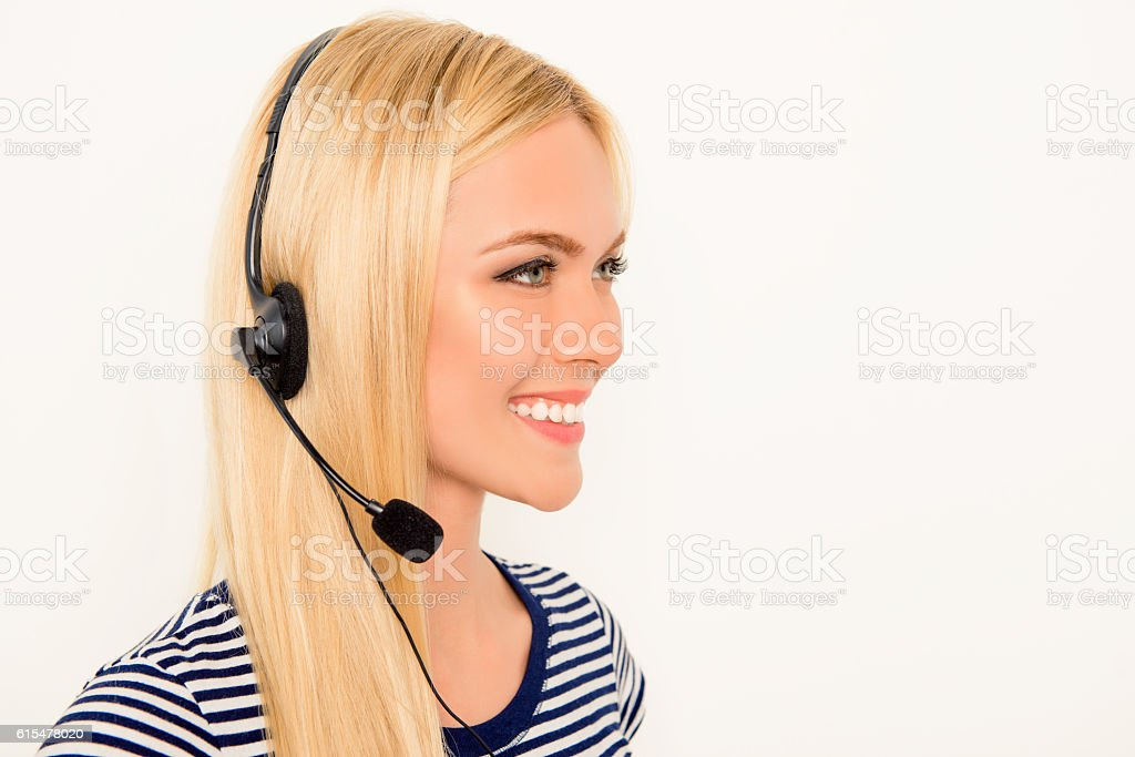 Side view portrait of cheerful pretty woman in headphones stock photo