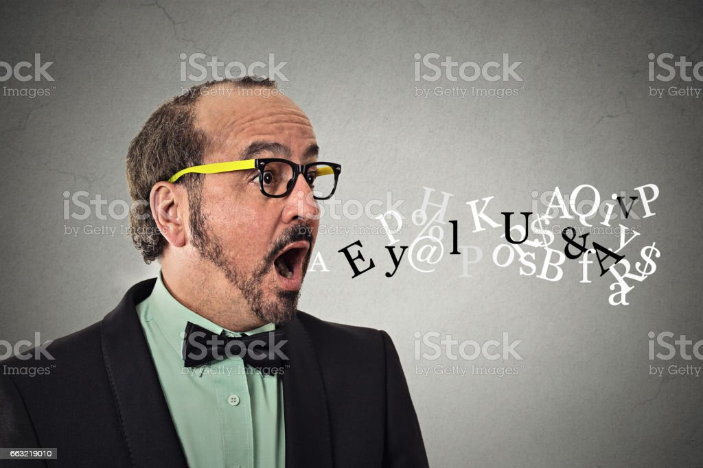 Side view profile portrait middle aged business man talking symbols alphabet letters coming out of his mouth stock photo