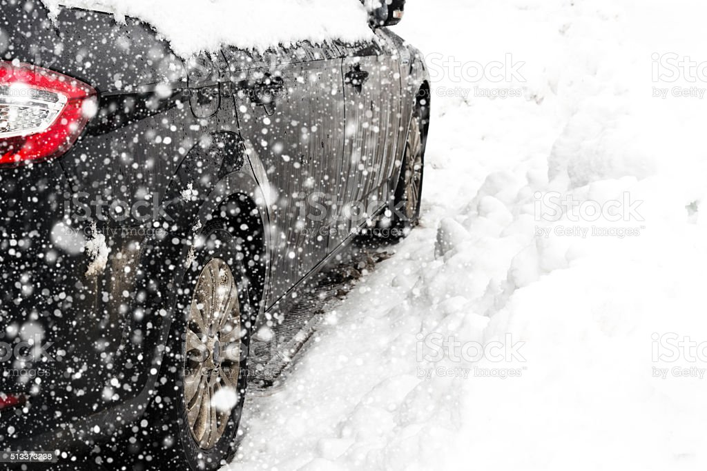 Side wiew of a car in the snow stock photo