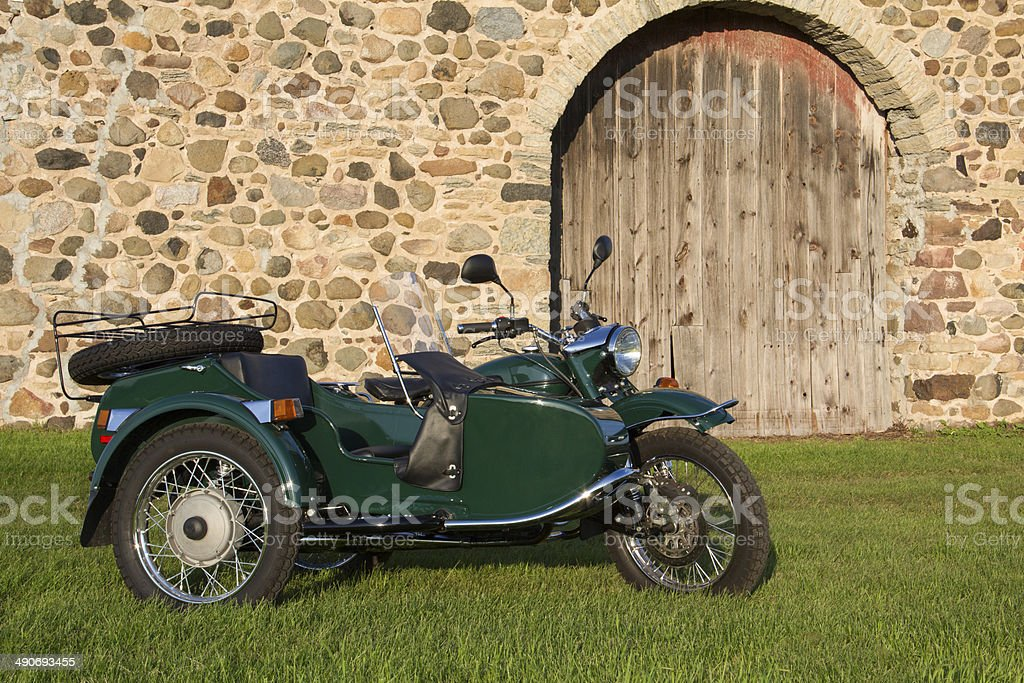 Sidecar Motorcycle - with Rustic Background stock photo
