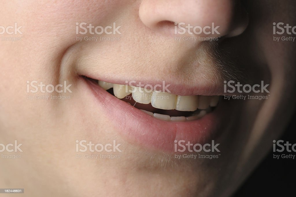 Sidelit smile with dimples royalty-free stock photo